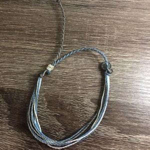 blue, white, and grey pura vida bracelet